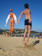 There were weird statues on the beach, so our friend Manu and I took some fun pics.