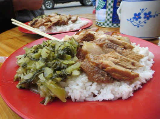 Roasted pork belly with a side of pickled vegetables.