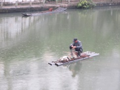 Bamboo boat in the rain